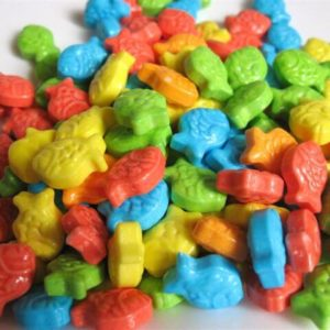 pile of assorted colorful Fish Food tart candies