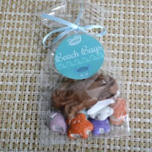 Bag wih Chocolate Crab on a bed of milk chocolate candy coated seashells