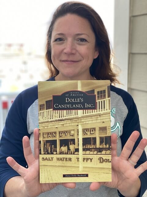 woman holding Images of America: Dolle's Candyland, Inc Book
