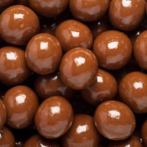 close up on pile of Chocolate Covered Malt Balls