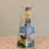 solid chocolate lighthouse inside clear lighthouse container