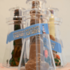 close up of solid chocolate lighthouses inside clear lighthouse containers