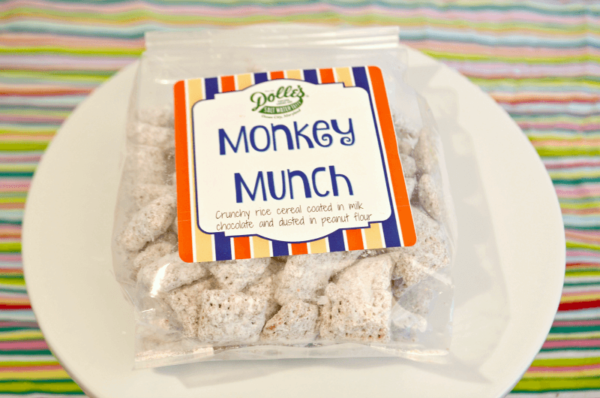 bag of Dolle's® Peanut Butter Monkey Munch on plate