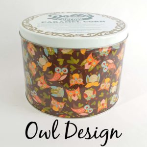 tin of Dolle's® Popcorn decorated with owls and heart shaped leaves artwork