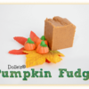 piece of Pumpkin Fudge on fall leaves with Mellowcreme Pumpkins