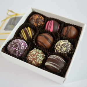 open box of 9 piece Gourmet Truffles